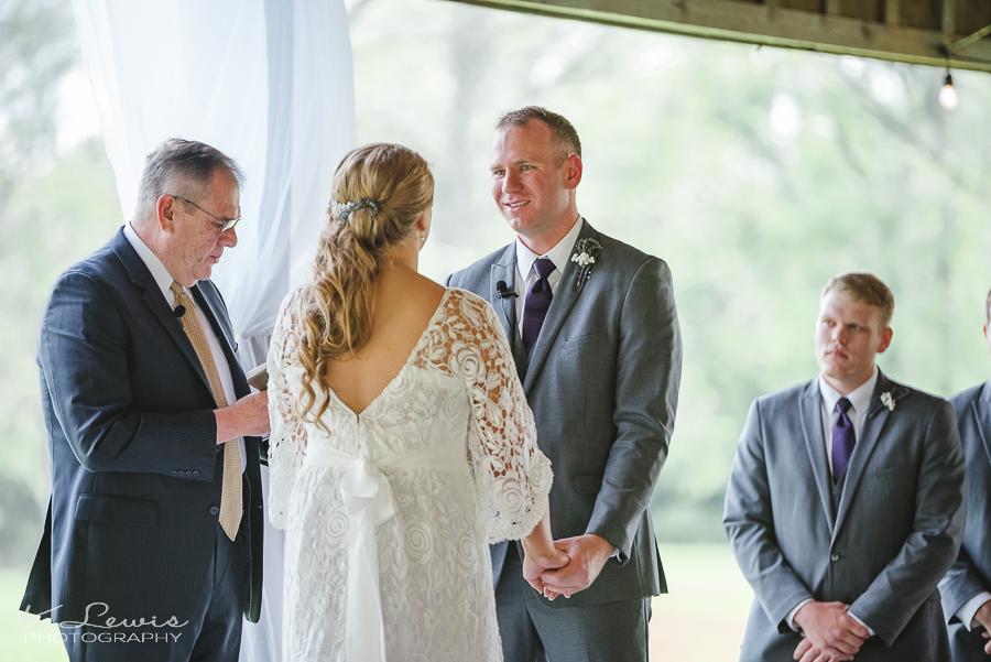 wedding photographer at the barn at water oaks farm laurel hill