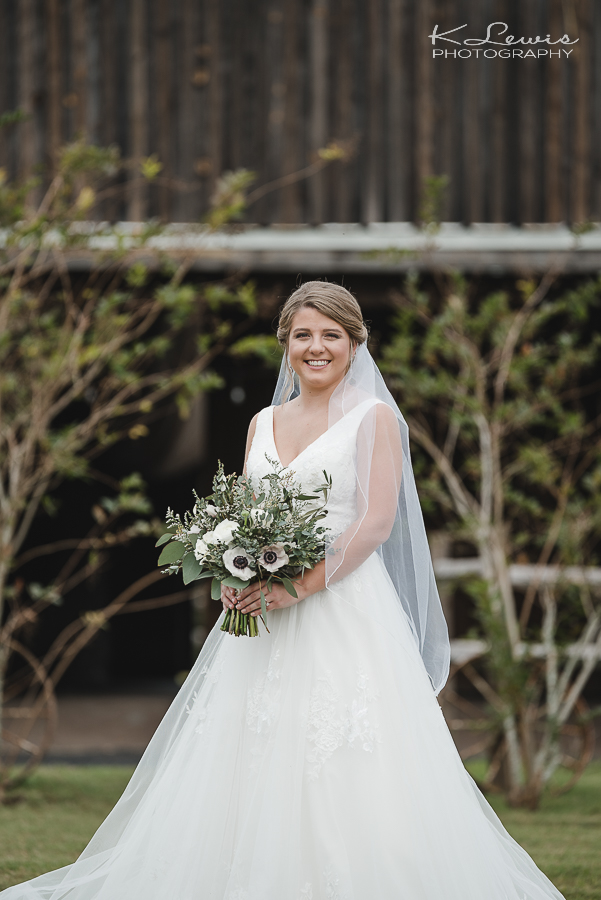 the barn at water oaks laurel hill wedding photographers